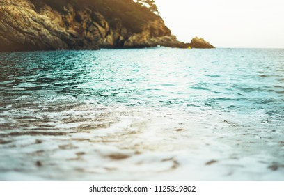 coastline beach on sunny day background of ocean and sky, gold sand close up blur, tourism relax calm concept mockup, seascape perspective vacation, summer seashore on blue sea waves and sand