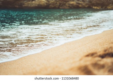 coastline beach on sunny day background of ocean, gold sand close up blur, tourism relax calm concept, seascape perspective vacation, summer seashore on blue sea waves and sand at sunset, mockup