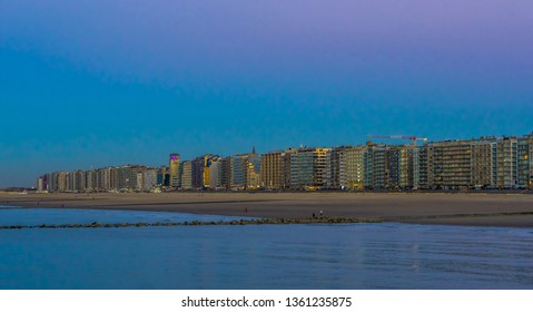 the coastline of Blankenberge, popular Belgian city at the beach, lighted city architecture by night in Belgium
