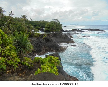 coastline with blowholes next to To Sua Ocean Trench, natural wonder of Upolu island, Samoa, South Pacific, Oceania