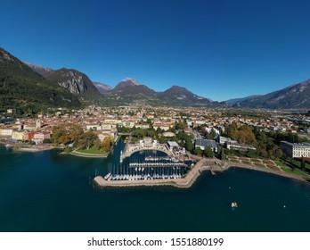 Coastline and boat parking the city of Riva del Garda, Italy. Autumn season. Aerial view, Lake Garda. Perfect blue sky