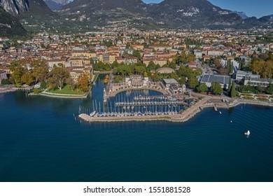Coastline and boat parking the city of Riva del Garda, Italy. Autumn season. Aerial view, Lake Garda