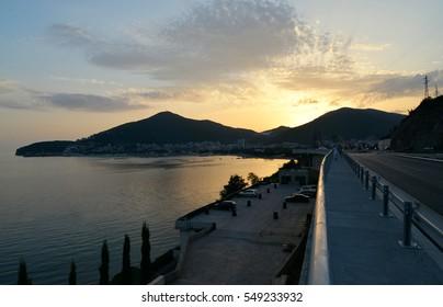 Coastline of Budva in Montenegro. Beautyful sunset. Landscape of european town near the sea.