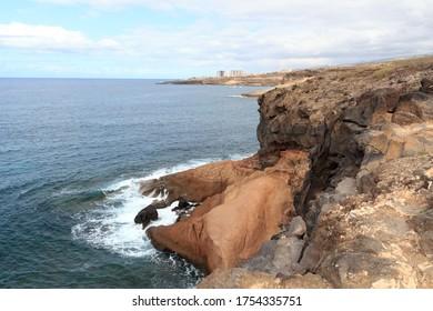 Coastline with cliffs and Atlantic Ocean near beach Playa de los Morteros on Canary Island Tenerife, Spain