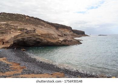 Coastline with cliffs at beach Playa de los Morteros on Canary Island Tenerife, Spain