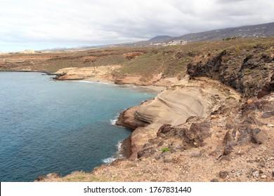 Coastline with cliffs at beach Playa de Diego Hernandez on Canary Island Tenerife, Spain