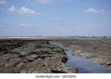 Coastline, coast, beach and dunes in Portbail, France