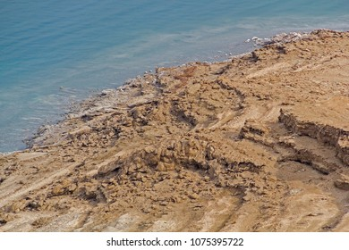 Coastline of Dead Sea - salt on coast and in water,View from above.Salt crystals natural mineral formation may be different forms .Dead Sea is the lowest place in the eath. Israel