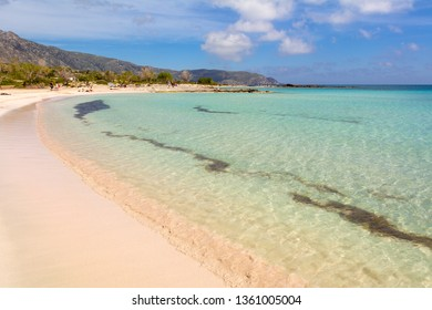 Coastline of Elafonisi beach with pink sand, warm and crystal clear water. Crete Island, Greece