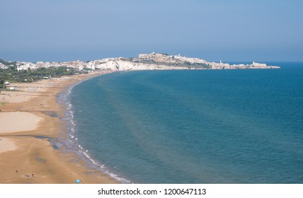 Coastline of the Gargano Peninsula in Puglia, southern Italy, with the town of Vieste on the horizon. Photographed on a clear day in late summer.