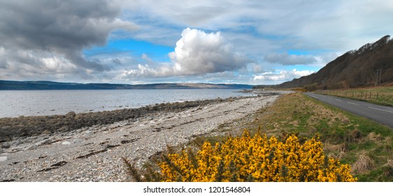 Coastline of the Isle of Arran in northwest Scotland. View across the Firth of Clyde to the Kintyre peninsula.