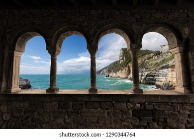 Coastline and the Mediterranean Sea. Church of San Pietro (1198) in Portovenere (UNESCO world heritage site) - La Spezia, Liguria, Italy