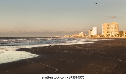 Coastline in Myrtle beach,SC,USA. Sunrise,sand,ocean foam,hotels.