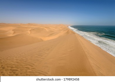 Coastline in the Namib desert near Sandwich Harbor. Sandwich Harbor is part of the Namib Naukluft National Park, and is one of the biggest sand fields in the world and a UNESCO world heritage site.