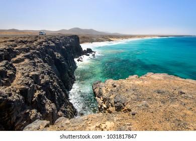 Coastline near El Cotillo village on Fuerteventura island on the sunset in Spain. Canary Islands.