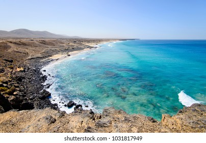 Coastline near El Cotillo village on Fuerteventura island on the sunset in Spain. Canary Islands.