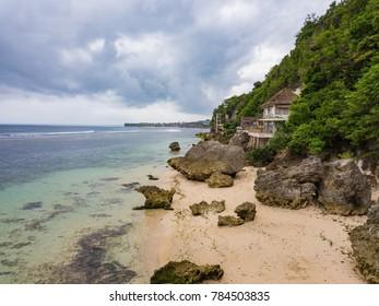 Coastline near Padang padang beach (Labuan Sait Beach) aerial view from drone, Bali island, Indonesia