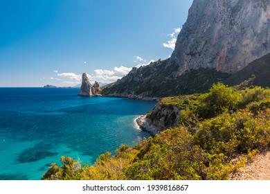 Coastline near Santa Maria Navarrese with rock pinnacle called Pedra Longa in the background (Sardinia, Italy)