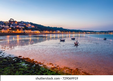 Coastline of Saint Aubin, Jersey, Channel Islands, UK at low tide and sunset