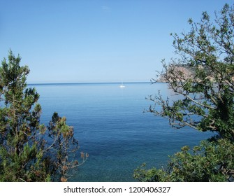 Coastline of sea with rocks and stones on the beach. Black sea. Crimea