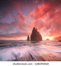 Coastline with sea stacks  in sunset time with red and purple light. Rialto Beach in Olympic National Park, Olympic Peninsula near Seattle, Olympia, Port Angeles. Washington. United States of America