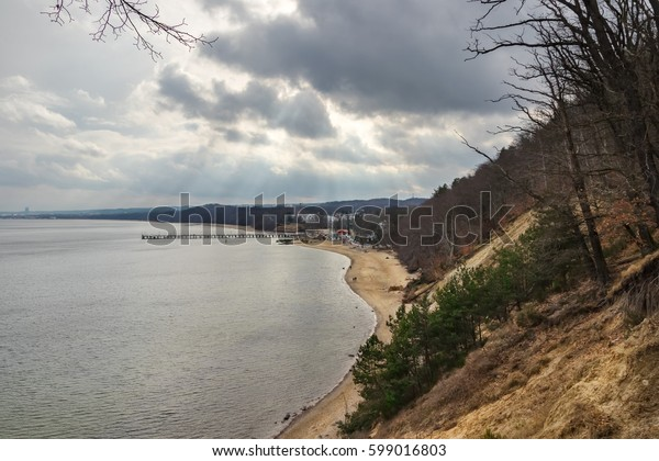 Coastline or seashore landscape with dramatic sky during a day.