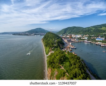 Coastline and sheer slope at sunny day aerial