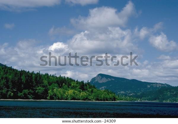 Coastline view - sea, sky and mountains