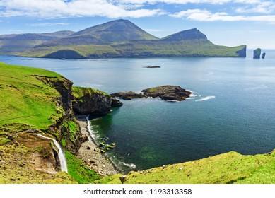 Coastline with waterfall near Bour town  , Faroe islands, Denmark