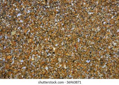 Coastline wet stones pattern background on Mediterranean sea