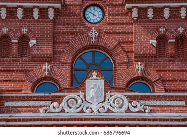 Coat of Arms and the clock on the facade of the railway station in Kazan, Russia