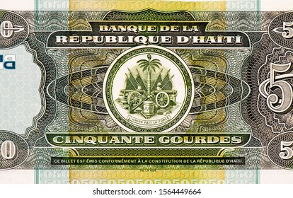 Coat of arms of Haiti (canons, flags, drum, anchor, soufflets, trumpet, sailing ship, palm tree with with Phrygian cap). Portrait from Haiti Banknotes. Hait money, Haiti bank note. Closeup Collection.