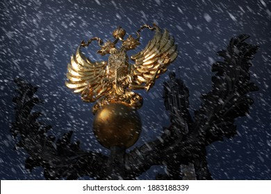 Coat of Arms of Russia is a Golden Double-Headed Eagle At night in Winter during a Snowfall. Concept Russia, News, Winter, Russian Federation, Politics, Sanctions, Moscow.