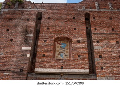 Coat of arms of Visconti family on the wall of the Filarete Tower of the Castello Sforzesco in Milan