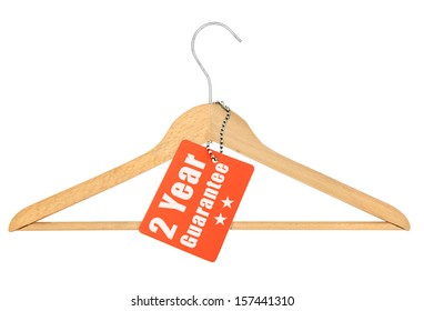 coat hanger with guarantee tag isolated on white background