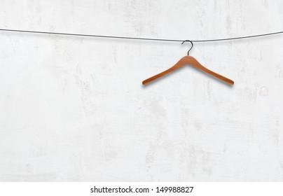 coat hanger on a white wall
