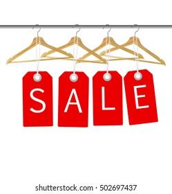Coat hangers on a clothes rail. Discount promotion concept.