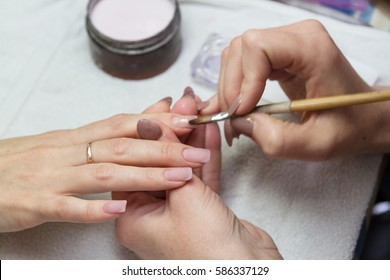 coated with acrylic nail specialist in the salon