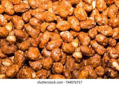 Coated nuts - peanuts, chocolate coated shocks background