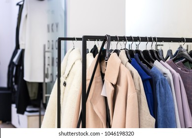 Coats on the sale. Fashion luxury elegance clothes in the shop. Stylist services, capsule spring wardrobe