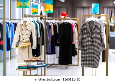 Coats on the sale. Fashion luxury elegance clothes in the shop. Stylist services, capsule fall autumn wardrobe