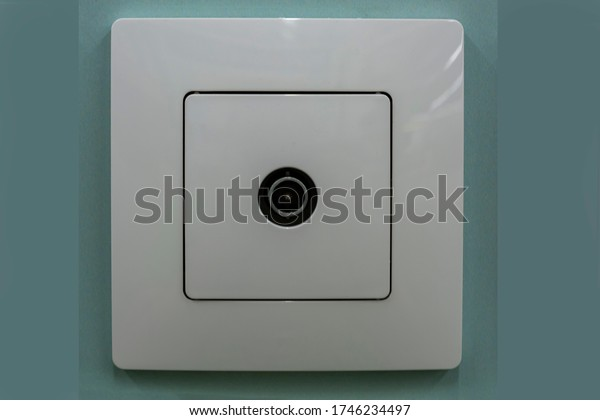 Coaxial Socket. Socket for tv and radio on a wall close-up. Antenna, cable tv box socket.