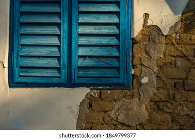 cob wall outdoor in Hungary with blue window