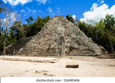 Coba, Mexico. Ancient mayan city in Mexico. Coba is an archaeological area and a famous landmark of Yucatan Peninsula. Cloudy sky over a pyramid in Mexico