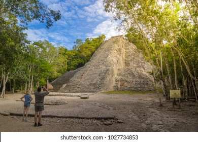 COBA, MEXICO - FEBRUARY 3, 2016: Tourists at the botom of Nohoch Mul pyramid in ancient Mayan city Coba,