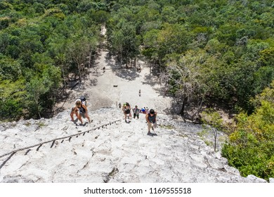 Coba, Mexico - Januari,2014: Tourist climb the Pyramid  at the ruins of the Mayan city Coba.