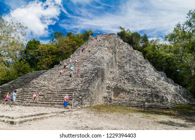 COBA, MEXICO - MARCH 1, 2016: Tourist climb the Pyramid Nohoch Mul at the ruins of the Mayan city Coba, Mexico
