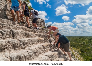 COBA, MEXICO - MARCH 1, 2016: Tourist climb the Pyramid Nohoch Mul at the ruins of the Mayan city Coba, Mexico