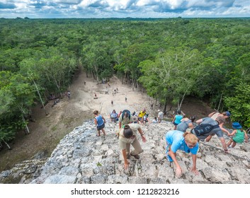 COBA, MEXICO - November, 13, 2013: Group of tourists climbing Nohoch Mul pyramid in Coba, Mexico