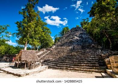 Coba, Mexico - November 16, 2010. Archaeological site of Coba with tourist and pyramid
